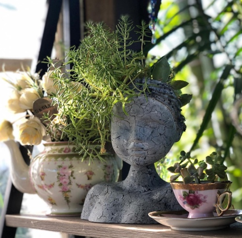 dolls heads and teacups